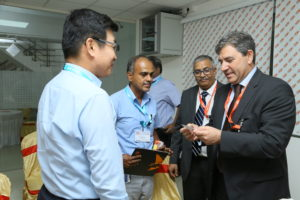 A moment in the event , Mr. Chari and Mr. Vicente Juan with customers